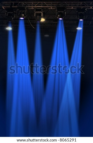 Stage lights in blue with metal rack - stock photo