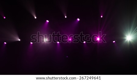 Stage lights on concert. Lighting equipment with multicolored beams. - stock photo
