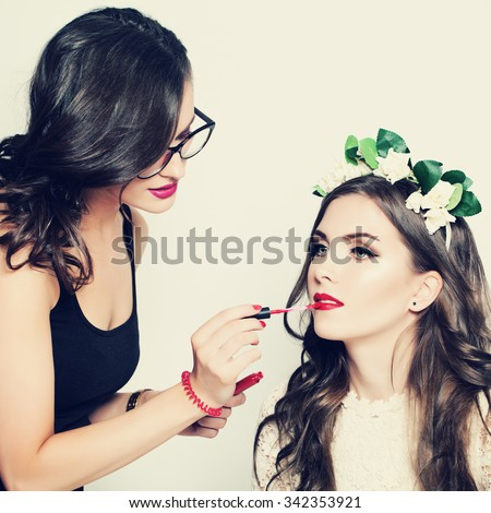 Stage Makeup. Make-up Artist and Beautiful Fashion Model - stock photo