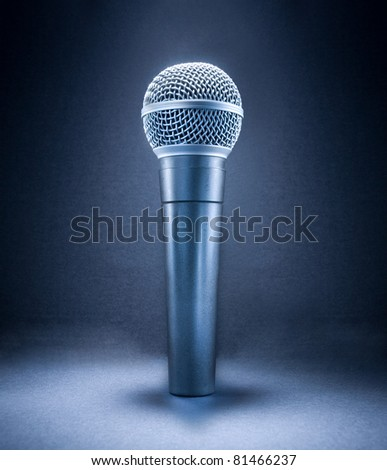 Stage microphone isolated on gray background. - stock photo
