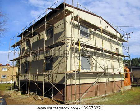 stage of the repaired walls of the building, insulation and renovation of the facade - stock photo