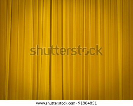 Stage Of The Theater With Yellow Curtains Closed