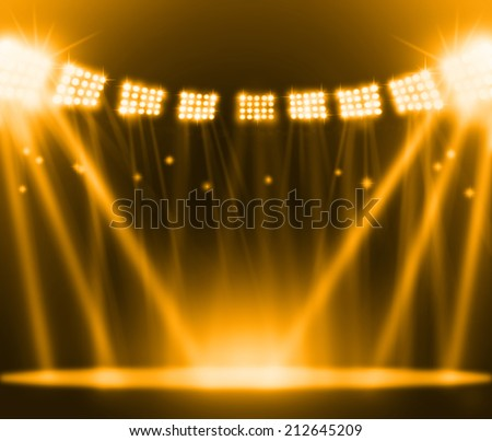 stage spot lighting over gold background. - stock photo