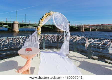 Stage wedding ceremony overlooking the river Neva - stock photo