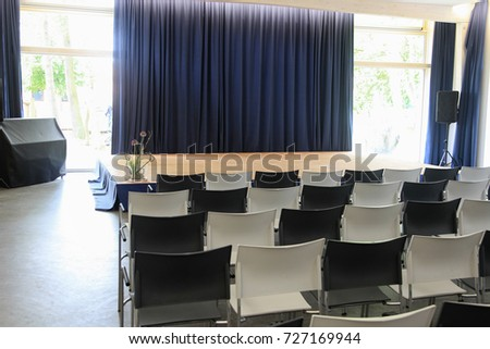 Stage With Chairs And Curtain