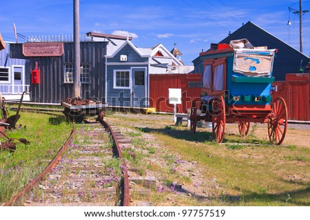 Stagecoach and a row of buildings at the World Museum Of Mining, Butte, Montana - stock photo