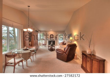 Staged living room in townhouse - stock photo