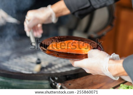 stages of cooking steak on the grill - ready piece of grilled steak with a grill in the background focus on different parts of the meat - stock photo