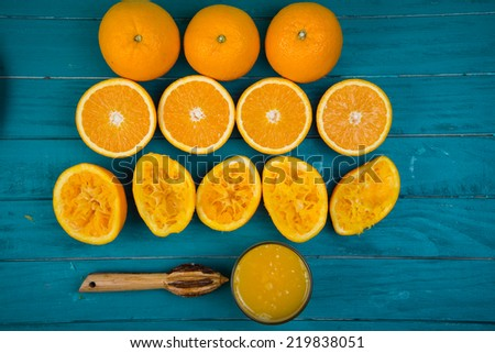 Stages of making fresh organic squeezed juice on wooden rustic table background - stock photo