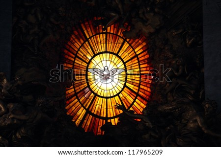 Stain glass behind the altar at St. Peters in the Vatican. - stock photo