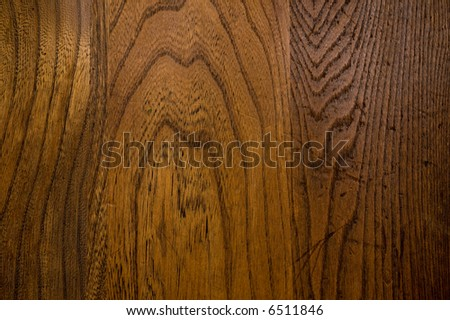 Stained and finished oak wood that has been grooved and worn by use - stock photo