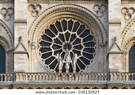Stained facade window of Notre Dame in Paris, France