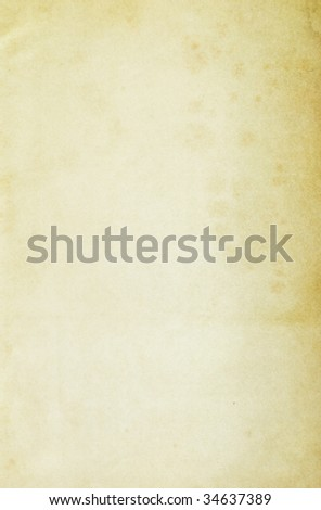 Stained faint yellow paper background. Copy-space. - stock photo
