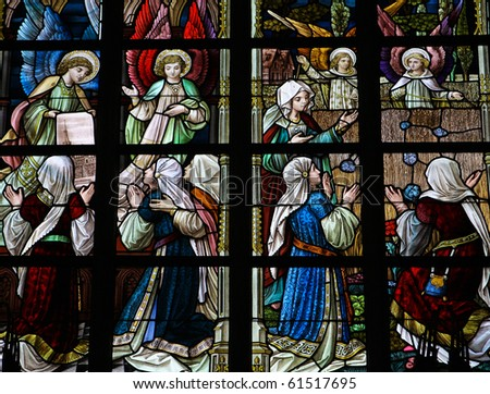 Stained glass church window in Church of Our Lady in Alsemberg, Belgium, made in 1895, depicting the image of the church shown by angels. - stock photo