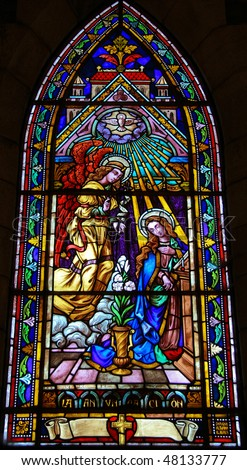 Stained glass church window (made at the end of the 19th Century) depicting the Annunciation