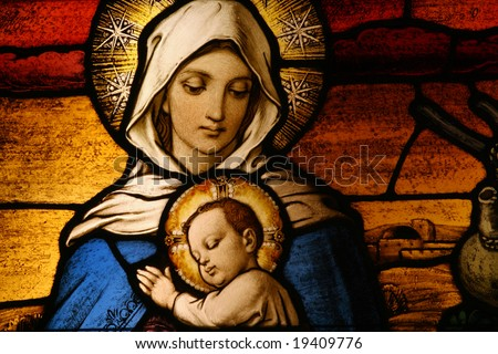 Stained glass depicting the Virgin Mary holding baby Jesus - stock photo