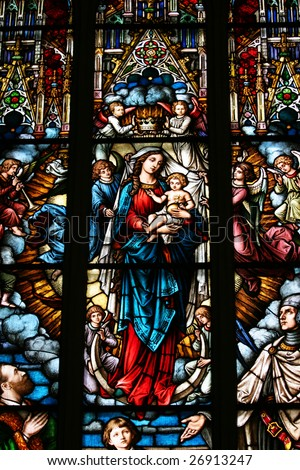 Stained glass depicting the Virgin Mary holding baby Jesus (Dome cathedral, Riga, Latvia)