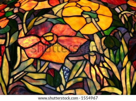 Stained glass golden rosy poppies closeup.  Antique arts & crafts original. - stock photo