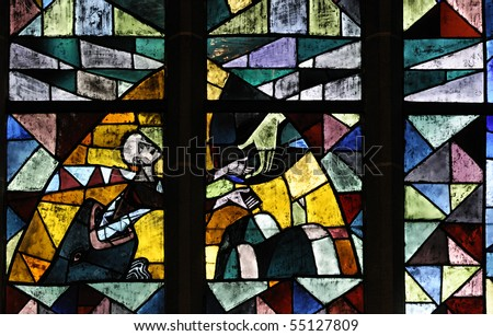 Stained glass in Bremen Cathedral (Bremer Dom or St. Petri Dom zu Bremen). With religion giving a hand of hope. - stock photo