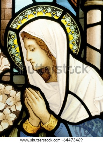 Stained glass in Catholic church in Dublin showing an Our Lady in deep prayer