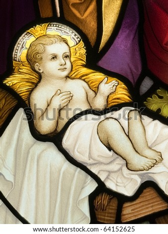 Stained glass in Catholic church in Dublin showing birth of Christ - stock photo