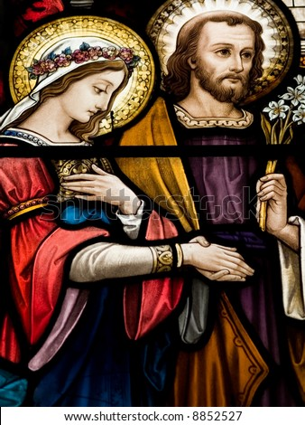 Stained glass in Catholic church in Dublin showing wedding of Mary and  Joseph - stock photo