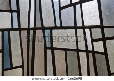 Stained glass in subtle pastel shades. Interesting design background. - stock photo
