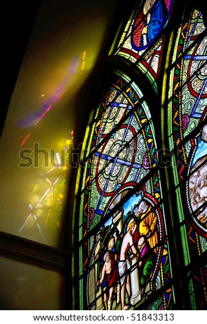 Stained glass is beautiful in the church. - stock photo