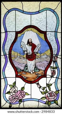 stained glass moses and ten commandments on black background - stock photo