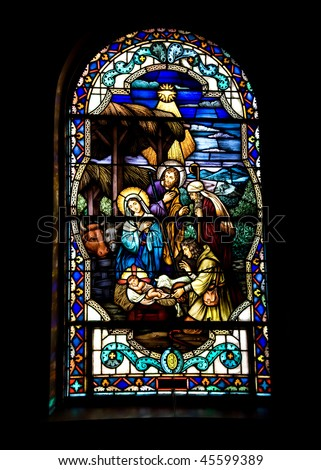 Stained glass-Nativity in window - stock photo
