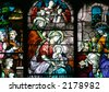 Stained Glass - Nativity Scene - Close-up on a church central window. - stock photo