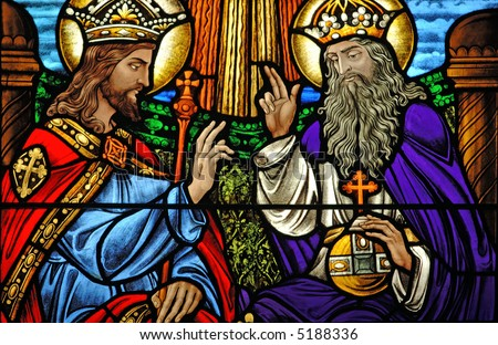 Stained glass of Jesus at the right hand of God from a 19th century ( built 1875 - 1899) church. - stock photo