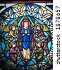 stained glass of mary an angels - stock photo