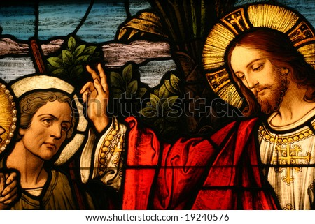 Stained glass showing Jesus blessing a man - stock photo