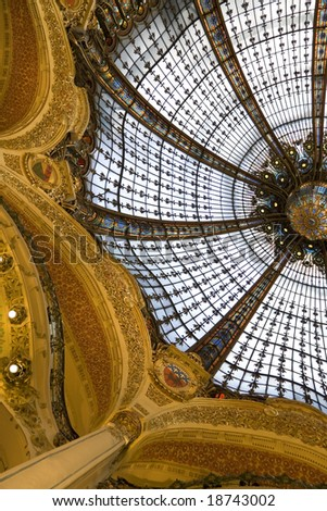 Stained glass skylight on the roof of Galleries Lafayette - stock photo
