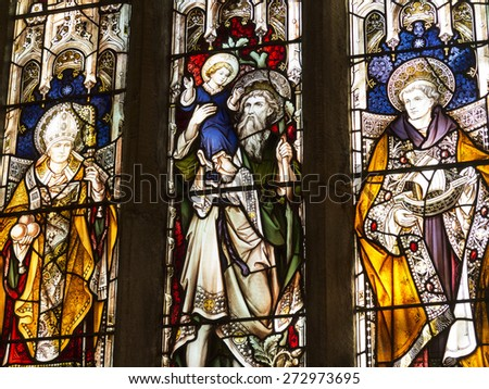 stained glass window at All Saints Church, Ashover village, derbyshire,UK . taken 22/03/2015