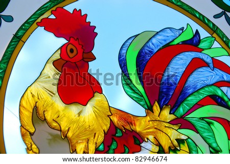 Stained-glass window. Cock. - stock photo