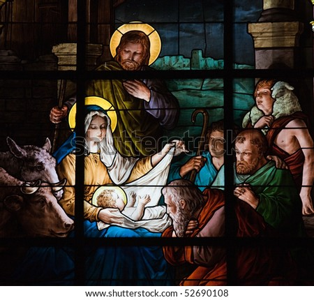 Stained glass window created by F. Zettler (1878-1911) at the German Church (St. Gertrude's church) in Gamla Stan in Stockholm, depicting the Nativity Scene - stock photo