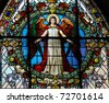 Stained glass window depicting an angel in the German Church in Gamla Stan, Stockholm. - stock photo