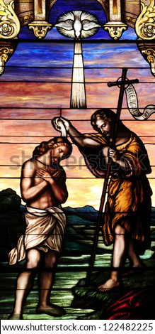 Stained glass window depicting baptism of Jesus Christ by St. John the Baptist - stock photo
