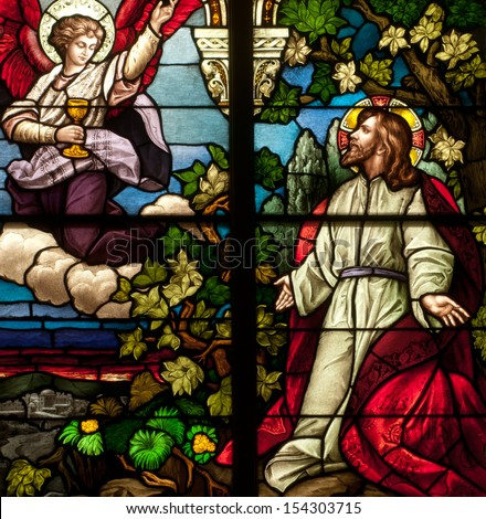 Stained glass window depicting Jesus Christ at Agony in the Garden - stock photo