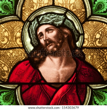 Stained glass window depicting Jesus Christ with crown of thorns - stock photo