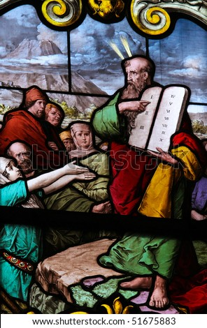 Stained glass window depicting Moses showing the Stone Tablets with the Ten Commandments. This window is located in Saint James's Church in Stockholm, capital of Sweden. It was fabricated in 1893. - stock photo