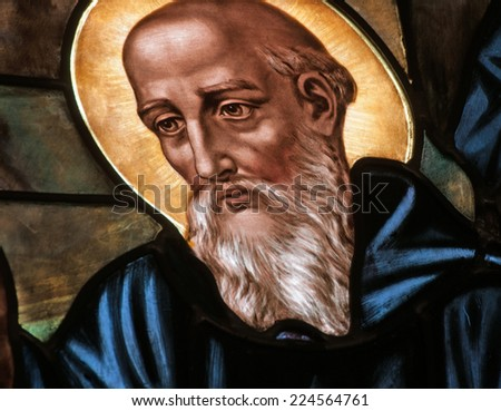 Stained glass window depicting St. Benedict of Nursia, author of the Rule of Benedict and patron saint of Europe - stock photo