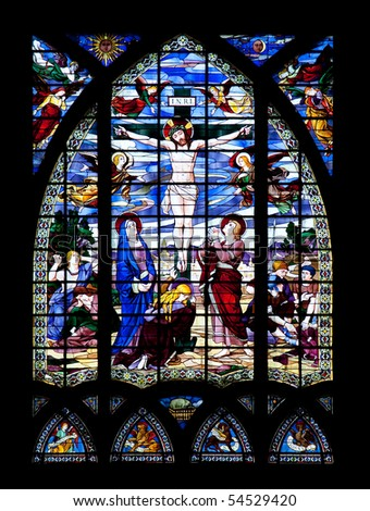 Stained glass window depicting the crucifixion of Jesus Christ. - stock photo