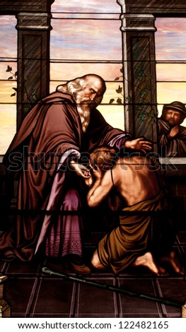 Stained glass window depicting the Gospel parable of the Prodigal Son - stock photo