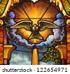 Stained glass window depicting the Holy Spirit in the form of a dove - stock photo