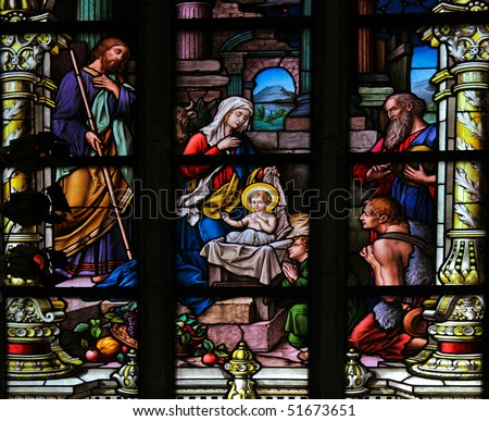 Stained glass window depicting the Nativity of Christ. This window is located in Saint James's Church in Stockholm. It was fabricated in 1893. - stock photo