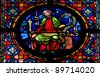 Stained glass window depicting the prophet Isaiah in the cathedral of Dinant, Belgium. - stock photo
