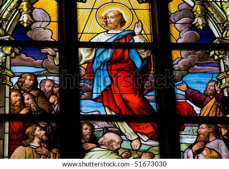 Stained glass window depicting the Resurrection of Christ. This window is located in Saint James's Church in Stockholm. It was fabricated in 1893, as indicated in the corner (not on picture). - stock photo